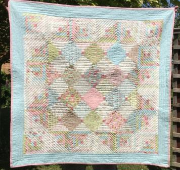 JELLYROLL OR LAYERCAKE LOG CABIN QUILT 48